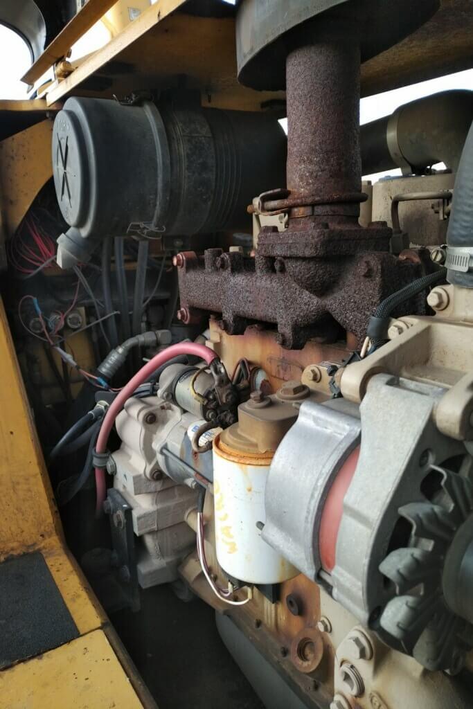 construction_equipment_air_filters_maintenance_repair_engine_compartment